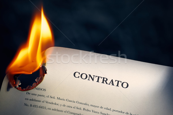 Closeup Of Contract In Spanish Burning On Fire Stock photo © diego_cervo