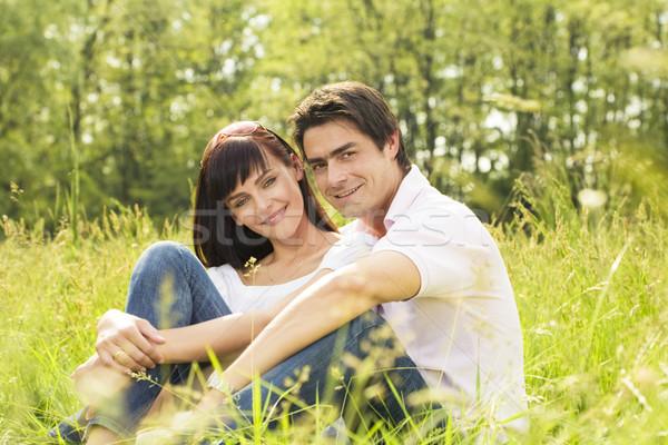 草原 カップル 草 笑みを浮かべて 女性 ストックフォト © diego_cervo