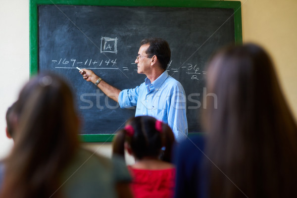 Middle Aged Teacher During Math Class At High School Stock photo © diego_cervo