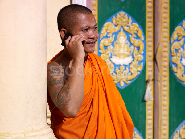 Asian buddhist monk talking with mobile phone in temple Stock photo © diego_cervo
