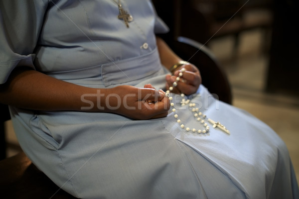 Women and religion, catholic sister praying in church, holding c Stock photo © diego_cervo