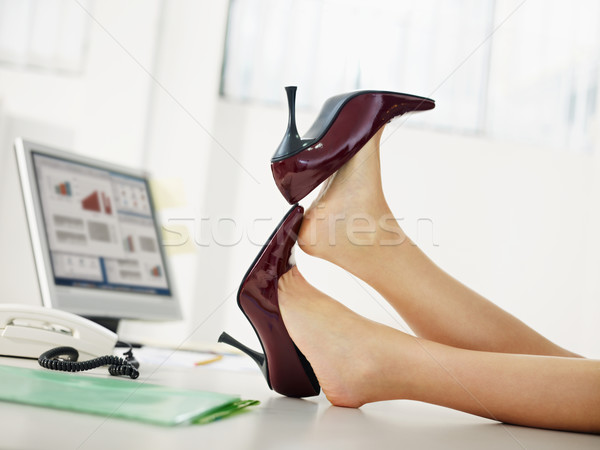 business woman taking off shoes Stock photo © diego_cervo
