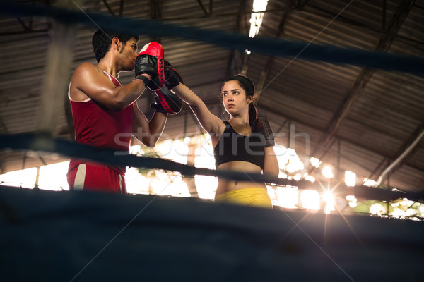 Young woman at boxing and self defense course Stock photo © diego_cervo