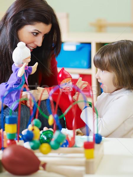 женщины учитель девочку играет детский сад лет Сток-фото © diego_cervo