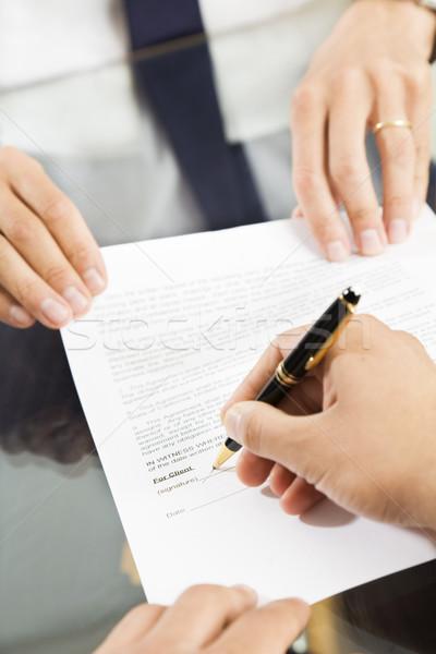 Iroda üzletember tart megállapodás aláírás közelkép Stock fotó © diego_cervo