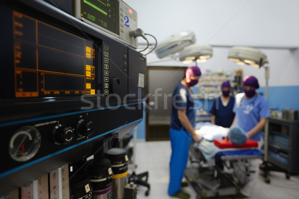 Operation room in clinic with medical staff during surgery Stock photo © diego_cervo