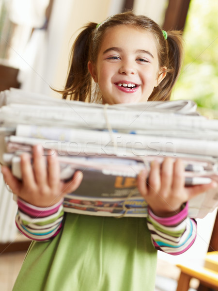 girl recycling newspapers Stock photo © diego_cervo