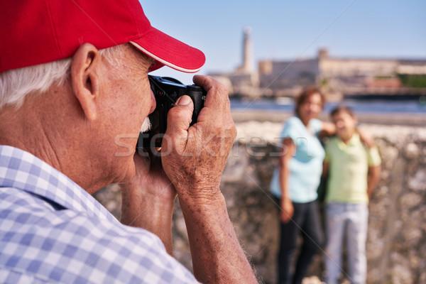 Grandparents With Boy Family Holidays Grandpa Taking Photo Stock photo © diego_cervo