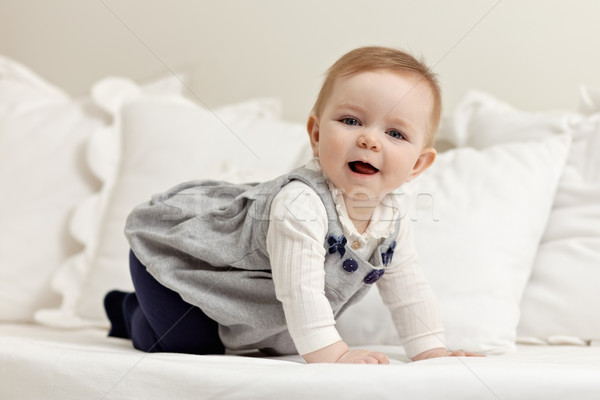 little girl walking all fours on bed Stock photo © diego_cervo