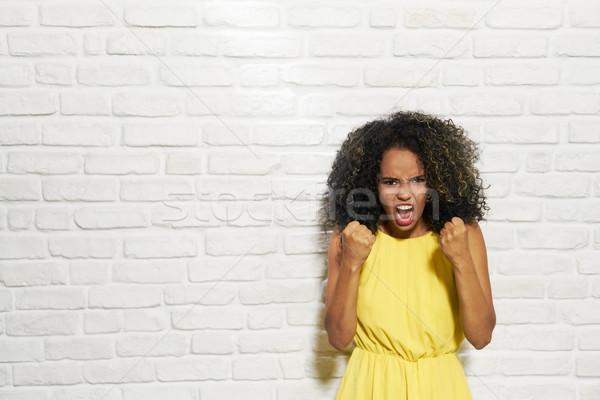 Stock fotó: Arckifejezések · fiatal · afroamerikai · nő · téglafal · portré · aggódó