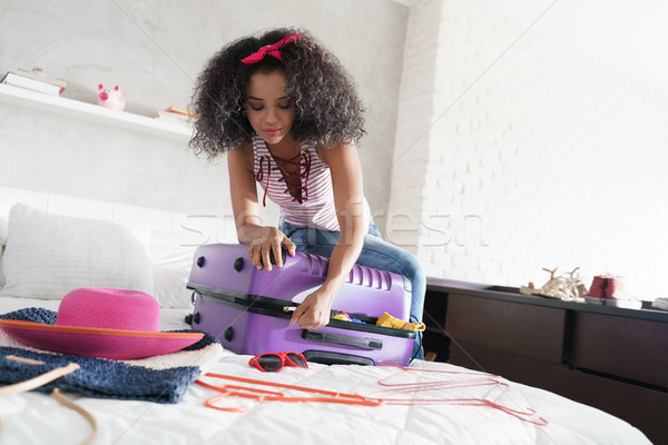 African American Girl Preparing Baggage For Vacation And Travel Stock photo © diego_cervo