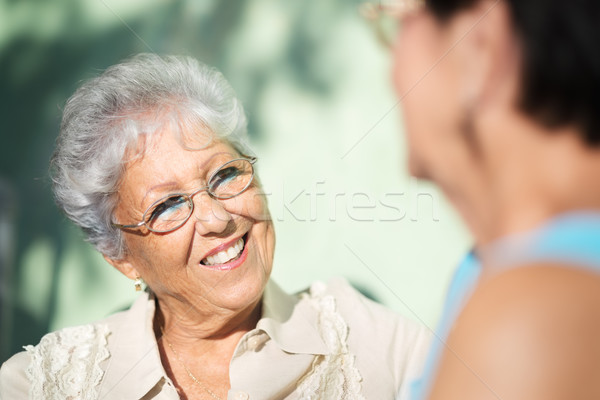 Old friends, two happy senior women talking in park Stock photo © diego_cervo