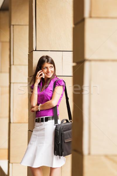 Fiatal üzletasszony telefon portré fiatal felnőtt beszél Stock fotó © diego_cervo