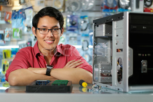 Portrait Of Chinese Man With PC In Computer Shop Stock photo © diego_cervo