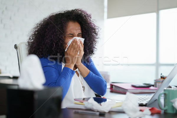 Black Woman Working from Home And Sneezing For Cold Stock photo © diego_cervo