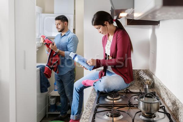 человека женщину работа по дому стиральные одежды Сток-фото © diego_cervo