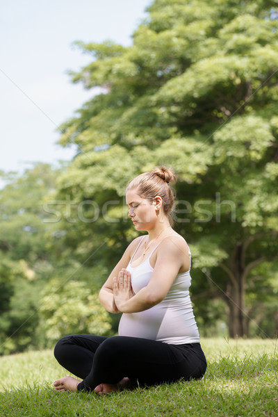 pregnant woman mother belly relaxing park yoga prayer Stock photo © diego_cervo