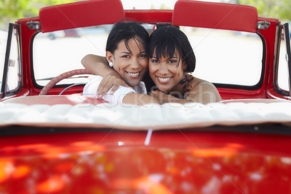 Stock photo: beautiful twin sisters hugging in cabriolet car