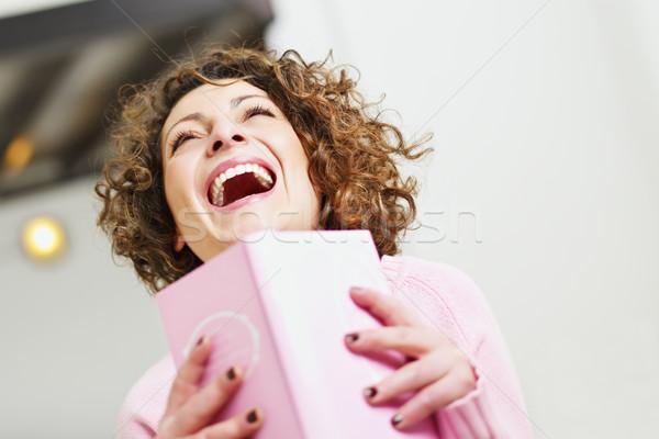 Kadın okuma kitap ev gülme bo Stok fotoğraf © diego_cervo