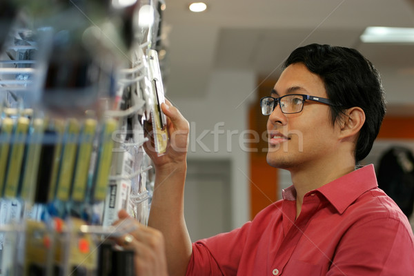 Happy Chinese Man Ordering Usb Drive In Computer Shop Stock photo © diego_cervo