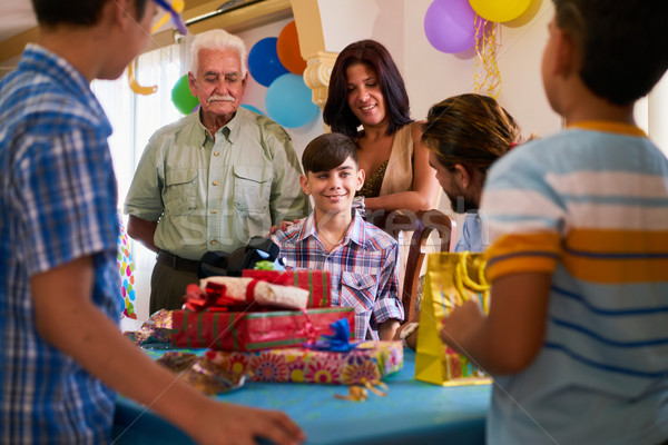 Boy With Family And Friends Celebrating Birthday Party Stock photo © diego_cervo