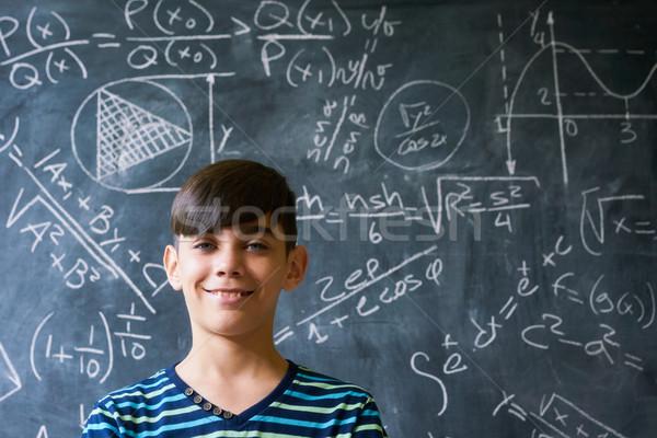 Portrait Genius Boy Smiling At Camera During Math Lesson Stock photo © diego_cervo