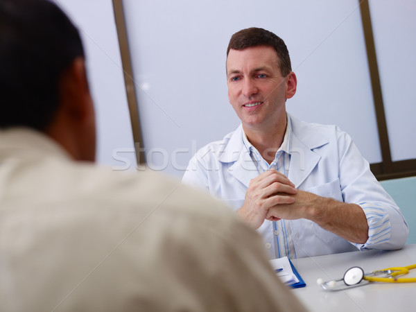 Stock photo: Doctor working and talking to old sick man in clinic