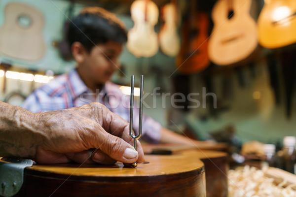 Lute Maker Grandpa With Diapason Tuning Guitar Boy Grandson Stock photo © diego_cervo
