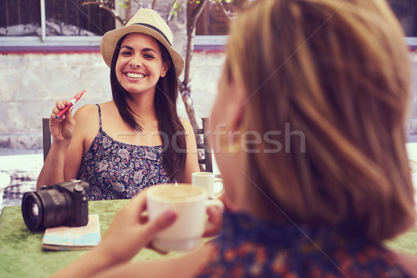 Happy Woman Smoking Electronic Cigarette Drinking Coffee In Bar Stock photo © diego_cervo