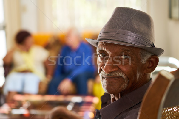 Senior Black Man With Hat Looking At Camera In Hospice Stock photo © diego_cervo