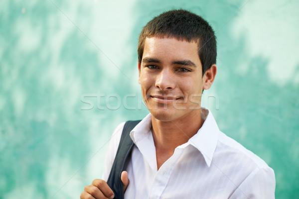 Сток-фото: колледжей · молодым · человеком · улыбаясь · портрет · молодые · Hispanic