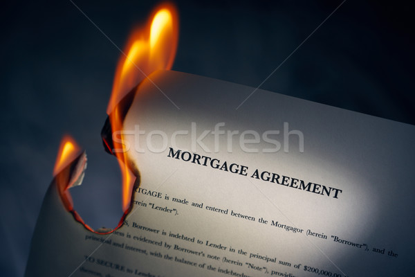 Mortgage Agreement Contract Burning On Fire Stock photo © diego_cervo