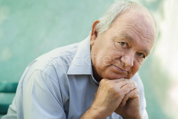 Portrait of sad bald senior man looking at camera Stock photo © diego_cervo