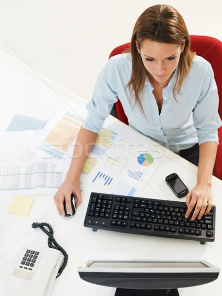 Employé de bureau femme d'affaires bureau ordinateur de bureau espace de copie affaires Photo stock © diego_cervo