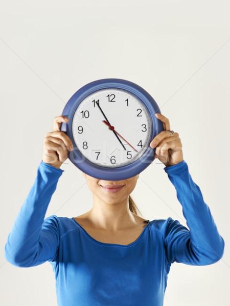 happy asian girl holding big blue clock Stock photo © diego_cervo