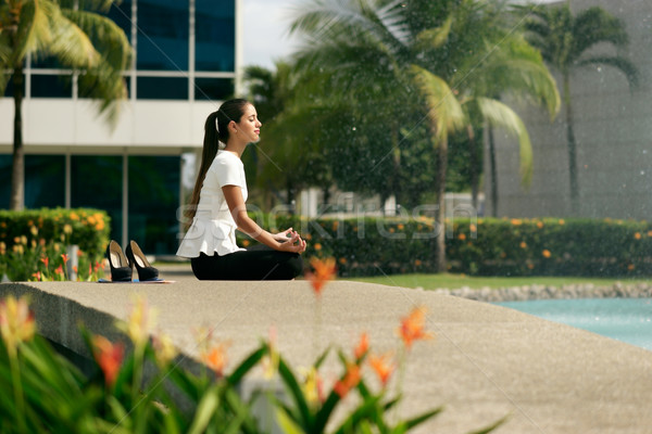 Relax Business Woman Yoga Lotus Position Outside Office Building Stock photo © diego_cervo