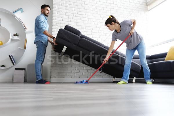 Man vrouw schoonmaken vloer Stockfoto © diego_cervo