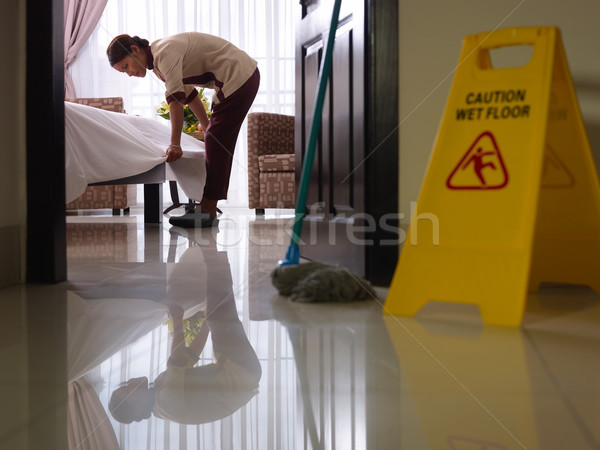Maid at work and cleaning in luxury hotel room Stock photo © diego_cervo