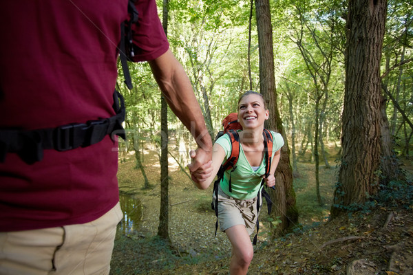 young couple trekking in forest and holding hands Stock photo © diego_cervo