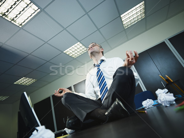 businessman doing yoga in office Stock photo © diego_cervo