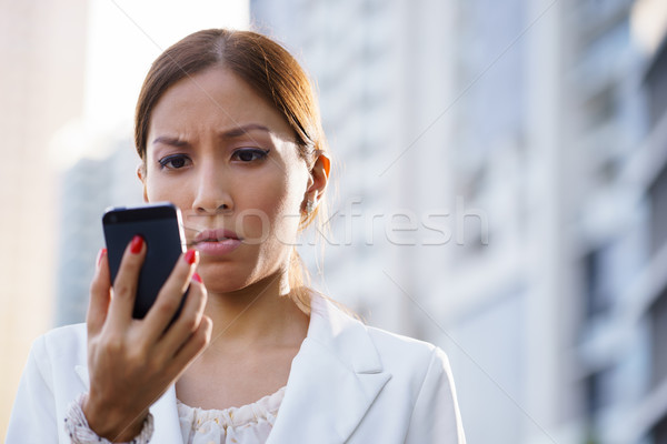 Portre üzücü iş kadını yazarak sms telefon Stok fotoğraf © diego_cervo