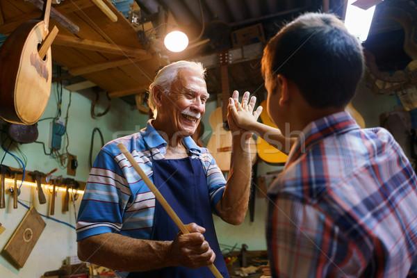 Senior Man Lute Maker Teaching Boy Chiseling Wood Stock photo © diego_cervo