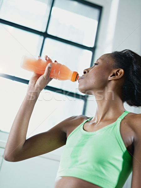 african woman in gym drinking energy drink Stock photo © diego_cervo