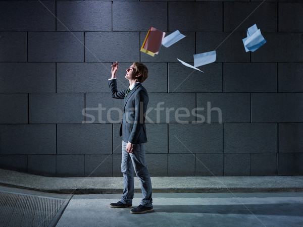 businessman throwing away files and documents Stock photo © diego_cervo