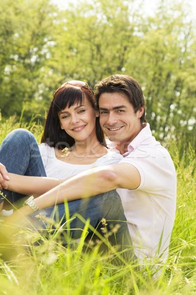 луговой пару трава улыбаясь женщину Сток-фото © diego_cervo