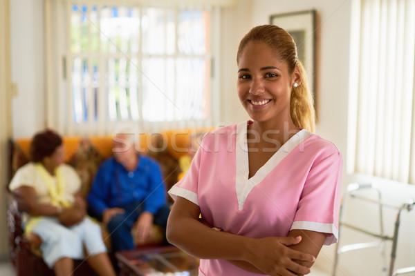 Boldog nő munka nővér kórház portré Stock fotó © diego_cervo