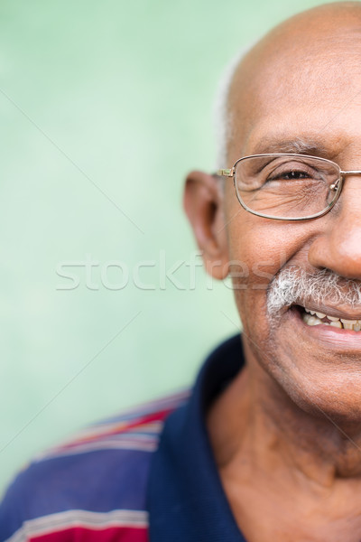 Old black man with glasses and mustache smiling Stock photo © diego_cervo