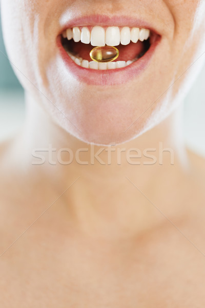 woman eating pill Stock photo © diego_cervo