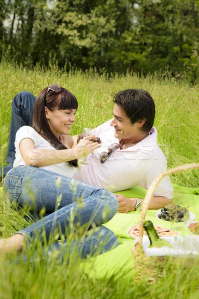 Legelő pár piknik park mosolyog étel Stock fotó © diego_cervo