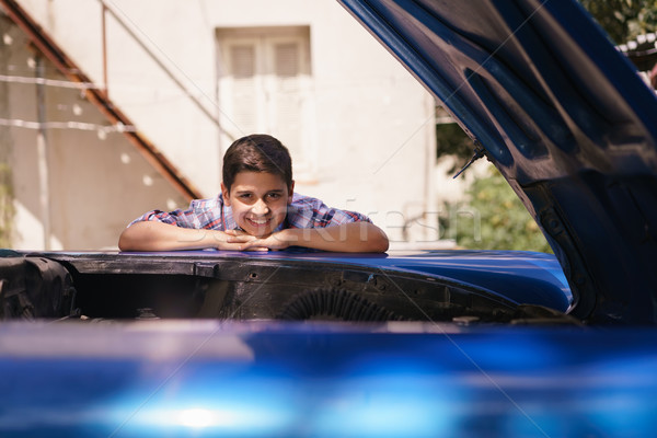 Portrait Amazed Grandchild Leaning On Hood Old Car Engine Stock photo © diego_cervo